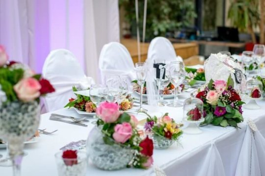 an elegant table setup for wedding event
