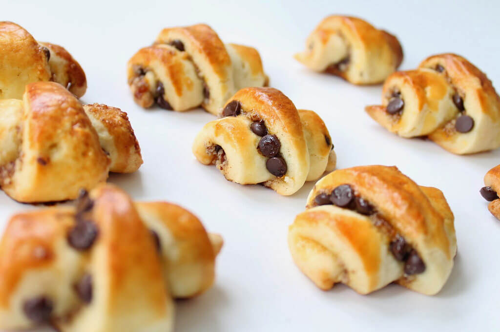 Nutella and Brown Butter Rugelach With Peanuts and Vanilla Glaze